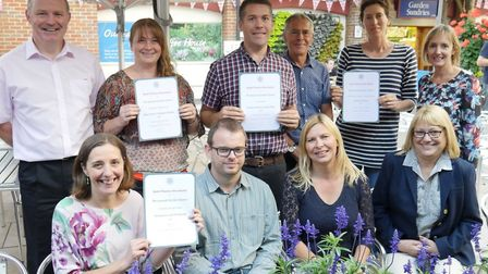 Members of the team from Perrywood Garden Centre and Nurseries with the four awards presented to the