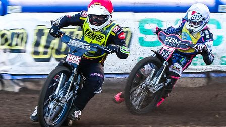 Nathan Greaves leads Josh Pickering during heat two of the meeting on Thursday between the Witches a