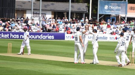 Essex bowler Paul Walter celebrates bowling out Shai Hope during day one of the match against the We