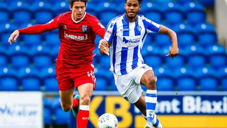 Frenchman Mikael Mandron, right, grappling for possession with Gillingham's Billy Bingham during the