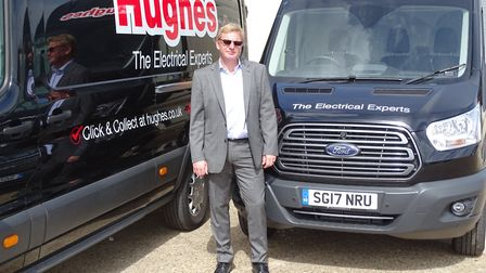 Mark Coleby, Service Director at Hughes, next to vans fitted with Lightfoot. Picture: DARREN BRANE/H