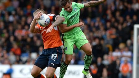 Lewis Kinsella, right, leaps for the ball with Luton's James Collins during last weekend's 3-0 defea