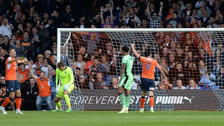 U's keeper Sam Walker, the man of the match, is left rooted to the spot as Luton add to their lead d