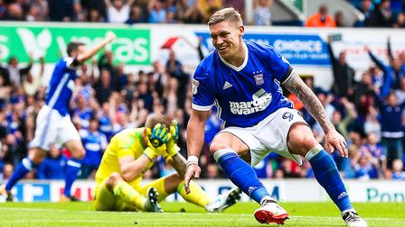 Brentford keeper Daniel Bentley has his head in his hands as Martyn Waghorn turns to celebrate after