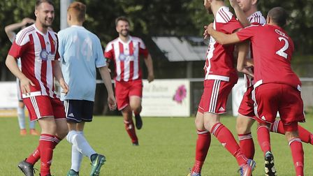 Felixstowe celebrate all three points against Godmanchester. Pictures: STAN BASTON