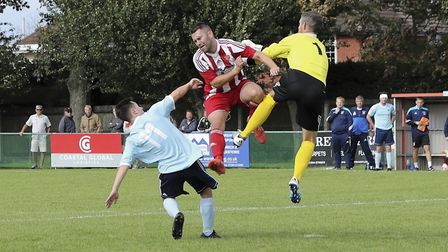 Felixstowe's Stuart Ainsley (red) in aerial challenge with Phil Peachey