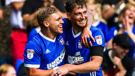 Towns first goal scorer Martyn Waghorn celebrates with the second, Joe Garner after he had scored to