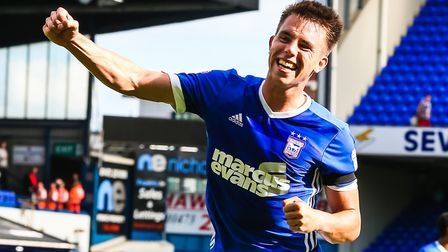 Jonas Knudsen taking on Luke Chambers fist pumps in his absence, after the Ipswich Town v Brentford