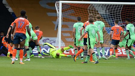 Colchester United concede the opening goal in first-half injury-time, Luton's Olly Lee scoring in a