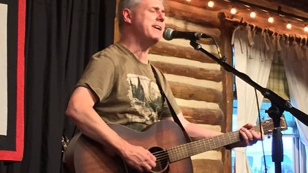 Tony James Shevlin on stage in Colorado Springs during his three month roadtrip which lead to the re