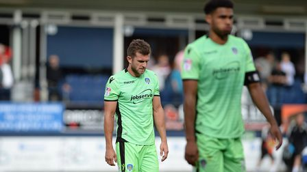 A disappointed Doug Loft (left) leaves the pitch at Kenilworth Road after Saturday's 3-0 defeat. Pic