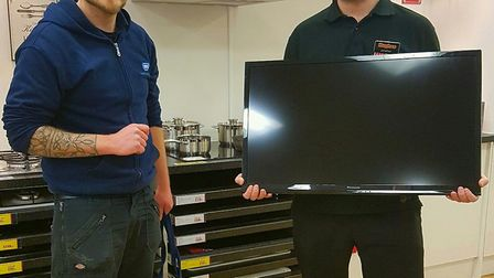 From left: Tom Patrick from RSPCA with Jonny Williams from Hughes Electrical , which has donated a