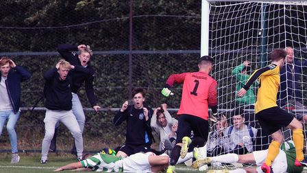 Fans react as Framlingham's Danny Smith and Jake Taylor both fail to put the ball in the empty net a