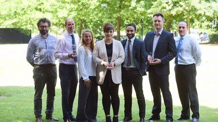 Team membesr at Sanctuary Personnel with the company's trophies from the EADT Business Awards, from