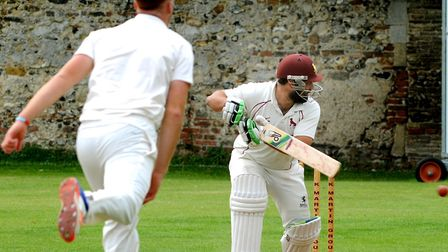 Sudbury batsman Ben Reece steers the ball away off the bowling of Dominic Manthorpe during the home