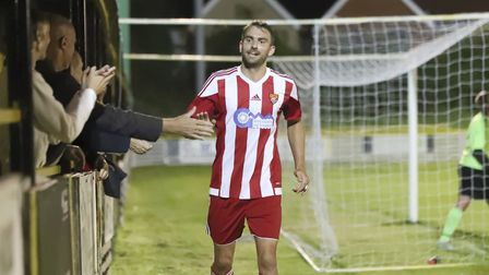 Joe Francis celebrates his goal with the Felixstowe fans in the win at Stanway. Picture: STAN BASTON