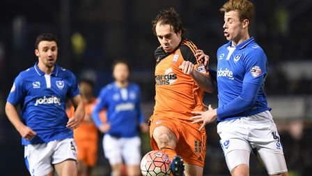 Adam Webster (right) tackles Ipswich Town's Brett Pitman, during Pompey's 2-1 FA Cup win in January