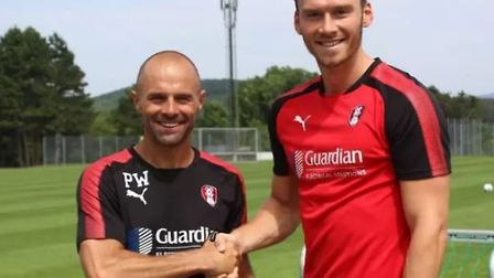 Kieffer Moore (right) and Rotherham boss Paul Warne, pictured after the Ipswich Town striker's loan