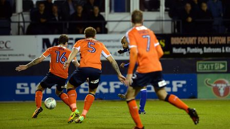 David McGoldrick scores his second with a shot threaded through a gaggle of players to give Ipswich