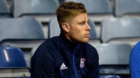 Adam Webster in the stand looking glum after coming off injured at Luton Town Picture Pagepix