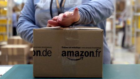 Internet giant Amazon saw a 50% fall in the amount of UK corporation tax it paid last year while it