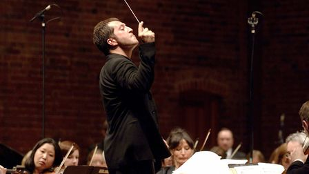 Composer Thomas Ades conducts the National Yoputh Orchestra as part of The Snape Proms. Photo:Malcol