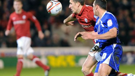 Barnsley defender Jimmy McNulty survives a penalty shout as Michael Chopra closes in during the firs