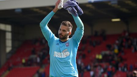 Ipswich keeper Bartosz Bialkowski applauds the travelling support after the win at Barnsley. Picture