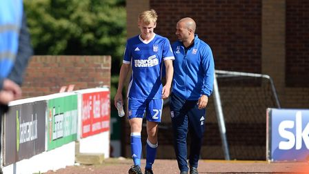 Flynn Downes is escorted back to the changing room at Barnsley by Andy Liddell