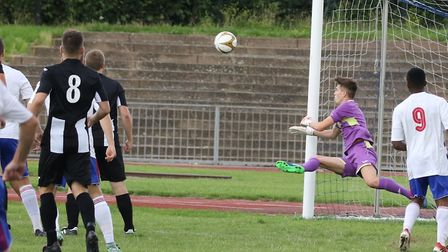 Alfie Stronge makes a great save for Woodbridge at Ilford