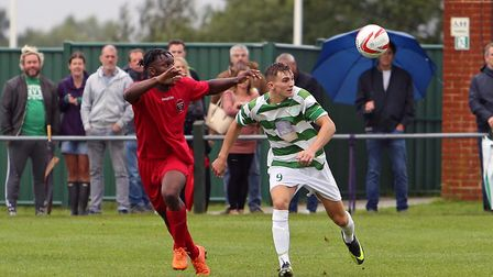 Framlingham Town, in green and white, battle Wadham Lodge in the FA Cup. Pictures: DEAN WARNER