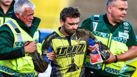 Kyle Newman is helped away by medics after crashing in the opening heat. Picture: STEVE WALLER
