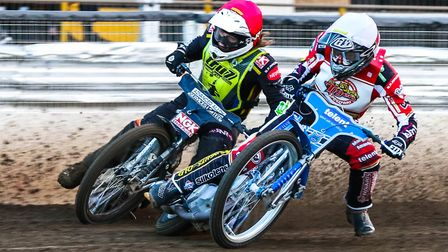 Nathan Greaves goes round Tom Bacon in heat two.