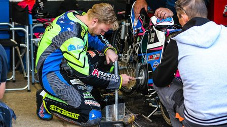 Cameron Heeps working on his bike during the meeting against Glasgow