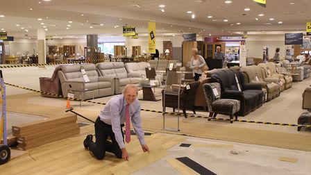 Paul Glasswell laying some flooring at home furnishing store Glasswells in Bury St Edmunds. The stor