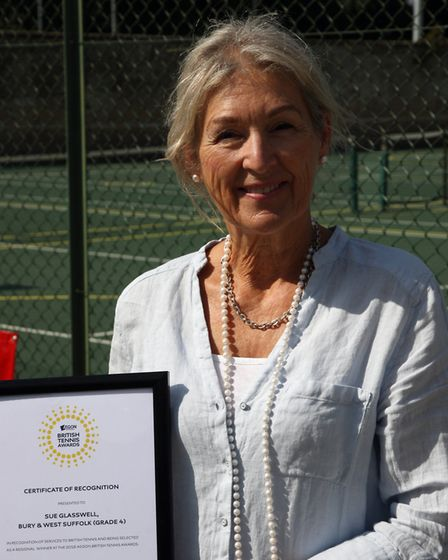 Tournament organiser Susan Glaswell with her certificate of recognition.
