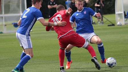 Luke Hyam (right) and Tyler French battling for the ball with Crewe's Jordan Bowery. Photo: Ross Hal