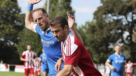 Branthams joint player/manager Michael Brothers (blue), plays close attention to former Leiston tea