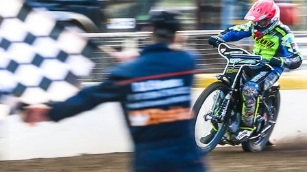 Danny King wins the opening heat of the Ipswich v Peterborough meeting. Pictures: STEVE WALLER