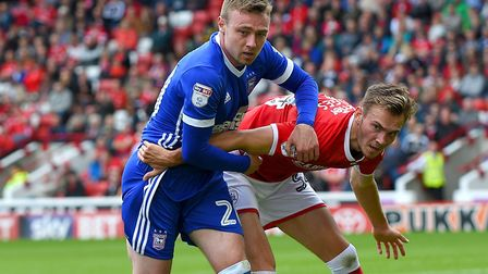 Freddie Sears holds off Ryan Hedges during Ipswich Town's 2-1 win at Barnsley. Photo: Pagepix.
