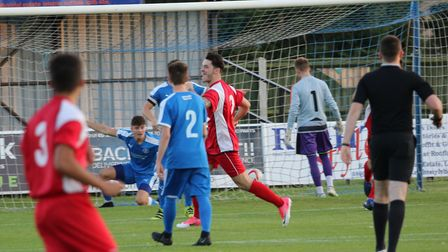 Woodbridge's George Bowman celebrates after Leiston Reserves' Harry Knights scored an own goal in th