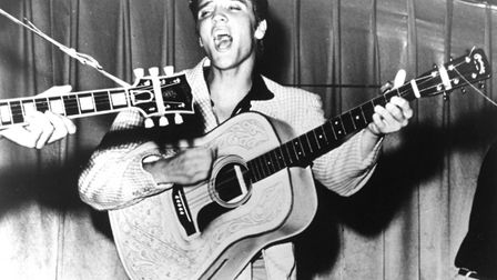This is a 1956 photo of Elvis Presley performing. This photo was used for his first RCA Victor albu