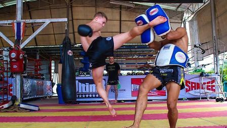 Joe Le Maire lands a jumping kick in training at Sumalee Boxing Gym. Picture: MR LEAF/SUMALEE BOXING
