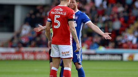 Joe Garner faces off with Angus MacDonald in a battle which continued throughout the second half at