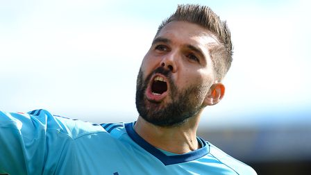 Ipswich keeper Bartosz Bialkowski celebrates with the travelling support after the win at Barnsley P