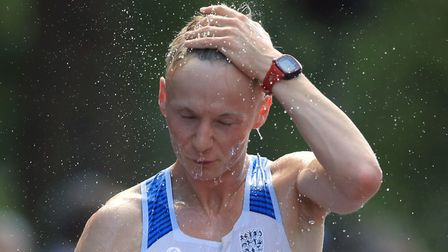 Callum Wilkinson feels the strain on his way to 41st spot in the men's 20K race walk in London. Pict