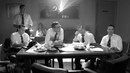 The news team discuss the McCarthy witch-hunts, Good Night and Good Luck. Photo: Redbus Film