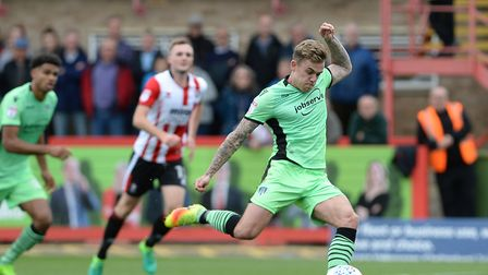 Sammy Szmodics makes no mistake from the penalty spot to make the score 2-1 at Cheltenham. Picture: