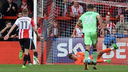 Sam Walker saves a second-half penalty from Brian Graham during yesterday's 3-1 defeat at Cheltenha