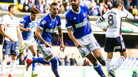 Bersant Celina races after teammate Cole Skuse as he celebrates after scoring to give Town a 1-0 lea